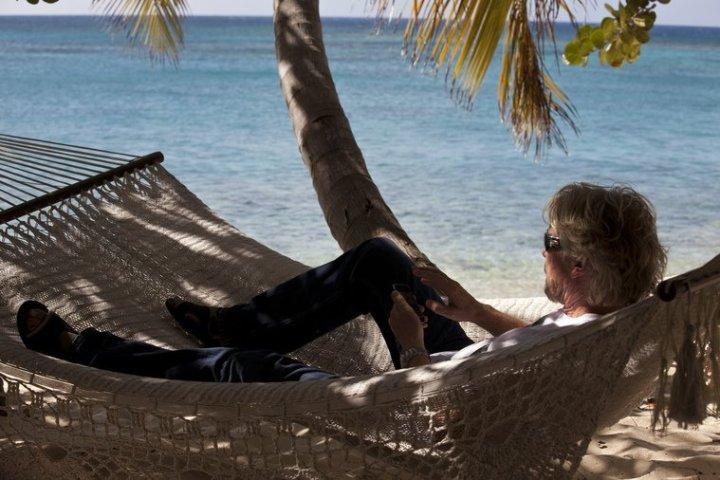 Richard Branson in his Hammock on Necker Island